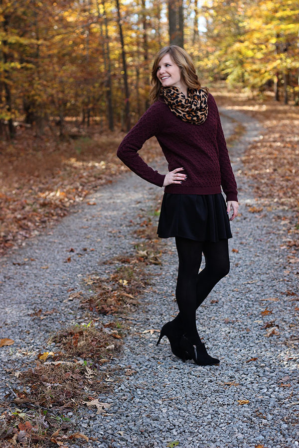 fit and flare dress styled for winter with booties, tights and a leopard scarf