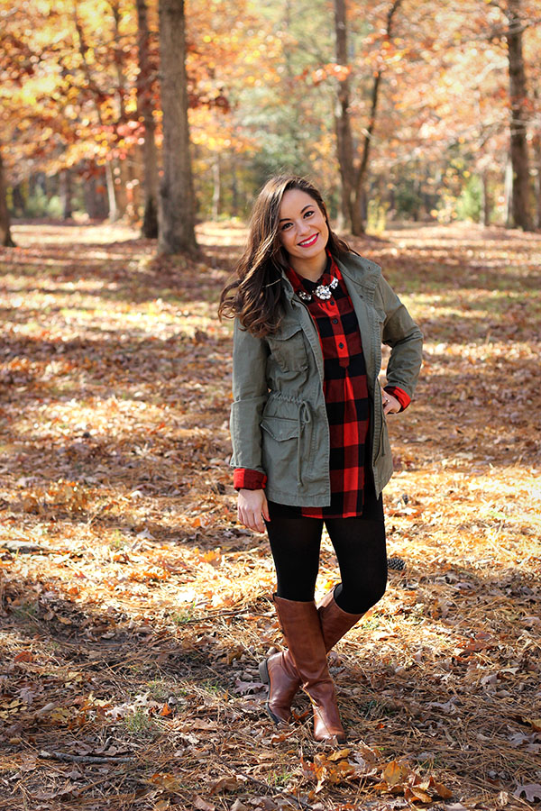 Brooke of Pumps and Push-Ups wearing Old Navy Utility jacket and buffalo check maternity shirt with riding boots and black leggings