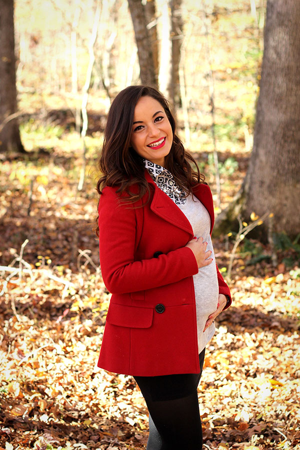 Brooke of Pumps and Push Ups wearing a mini skirt,tights, booties, red coat with button down and statement necklace
