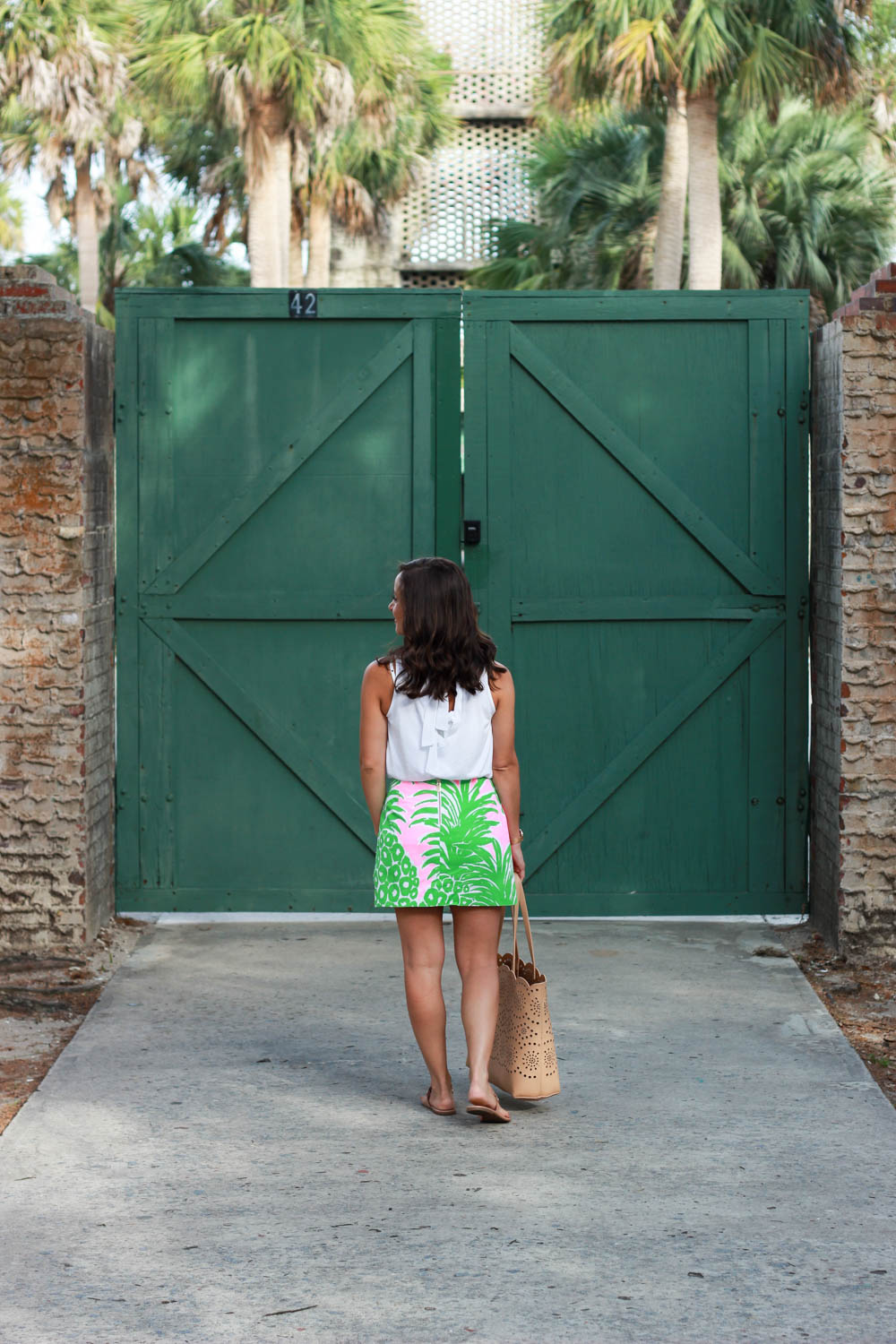 Blogger Brooke of Pumps and Push-Ups, wearing a Lilly Pulizer skirt and a Loft Shirt