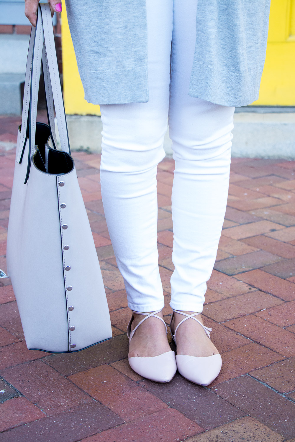 Ruffled tank top under a cardigan outfit with white jeans and blush flats